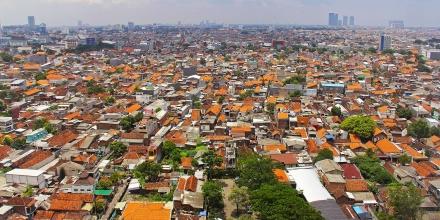Bird's eye view over orange rooftops of Surabaya city